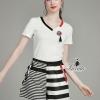 เสื้อผ้าเกาหลี พร้อมส่งwatch stylish decorated v neck top striped pants pretty set