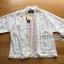 เสื้อผ้าเกาหลี พร้อมส่งเสื้อคลุมผ้าคอตตอนสีขาวชายพู่ปักลายสไตล์โบฮีเมียน thumbnail 12