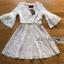 ชุดเดรสเกาหลี พร้อมส่งเดรสผ้าลูกไม้สีขาวงาช้างแขนบานพร้อมเข็มขัด thumbnail 6