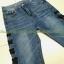 เสื้อผ้าแฟชั่นพร้อมส่ง กางเกงยีนส์ ขายาว แต่งตาไก่ร้อยเชือกผูกโบว์สีดำ งานสวยมาก thumbnail 6