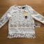เสื้อผ้าเกาหลี พร้อมส่งเสื้อผ้าลูกไม้สีขาวซีทรูประดับชายพู่สไตล์เฟมินีน thumbnail 10