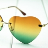 แว่นตาแฟชั่นเกาหลี กรอบหัวใจขาทองสุดไฮโซเลนส์ส้มเขียว
