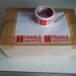 TAPE FRAGILE เทปเตือน ระวังแตก พื้นสีขาว ตัวอักษรสีแดง หน้ากว้าง 2 นิ้ว ยาว 45 หลา ( 41 เมตร )