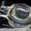 ควอตซ์ใสแกะรูปศิวลิงค์คัม พร้อมฐานกระจก (6.8g)