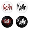 ของที่ระลึกวง Korn เลือกด้านหลังได้ 4 แบบ เข็มกลัด, แม่เหล็ก, กระจกพกพา หรือ พวงกุญแจที่เปิดขวด 1 แพ็ค 4 ชิ้น [10]