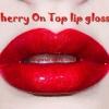 ลิปกลอส Lime crime Carousel Gloss Cherry On top Glitter lip gloss ลิปกลอสสีแดงอมชมพูเจลลี่ พร้อมกับกลิตเตอร์สีรุ้ง น่ารักมากๆ