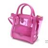 กระเป๋าเนื้อพลาสติกสีใส สลับหนังเย็บ แต่งดีเทลที่ด้านล่างสวย ๆ
