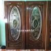 ประตูไม้สักกระจกนิรภัย วงรี แกะองุ่น เกรด A รหัส NNA25