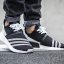 WHITE MOUNTAINEERING NMD_R2 PRIMEKNIT SHOES Color Core Black/Footwear White thumbnail 9