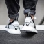 WHITE MOUNTAINEERING NMD_R2 PRIMEKNIT SHOES Color Core Black/Footwear White thumbnail 12
